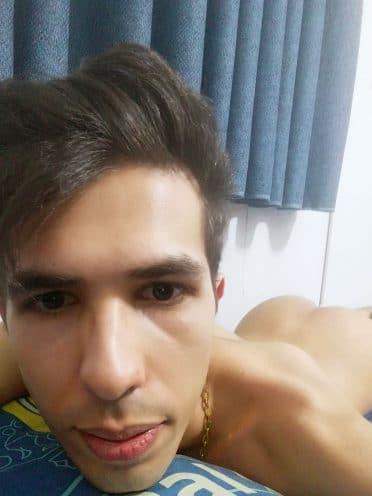 Guy Taking Selfie On Bed Naked