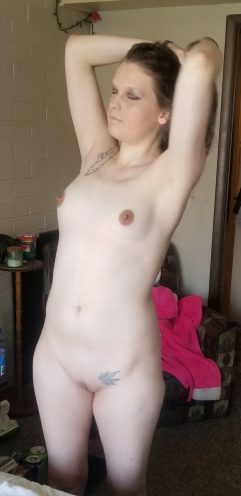 Naked amateur woman with nice tits and bald pussy
