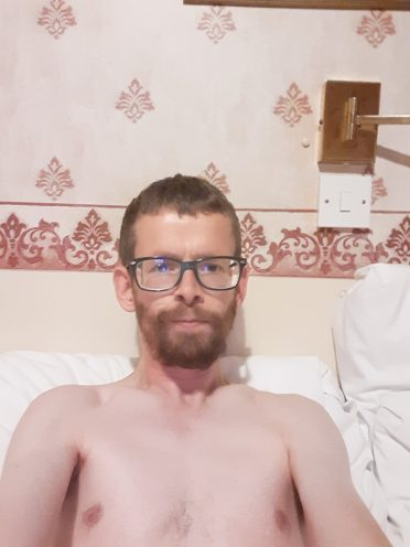 Shirtless Redhead Guy With Glasses and beard